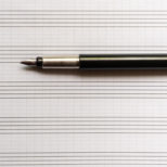 empty blank music notebook with fountain pen, copy space mockup, macro shot